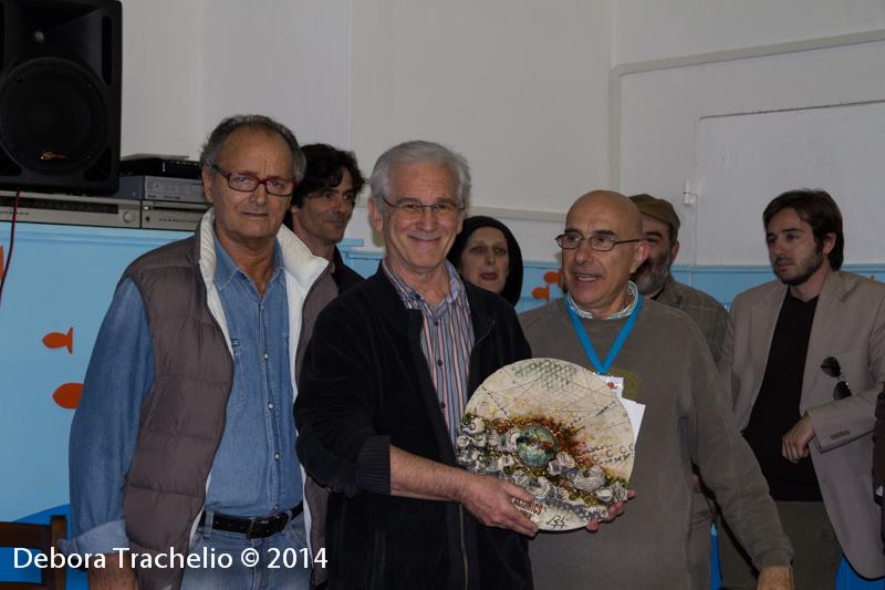 Simon Rocca (al centro)